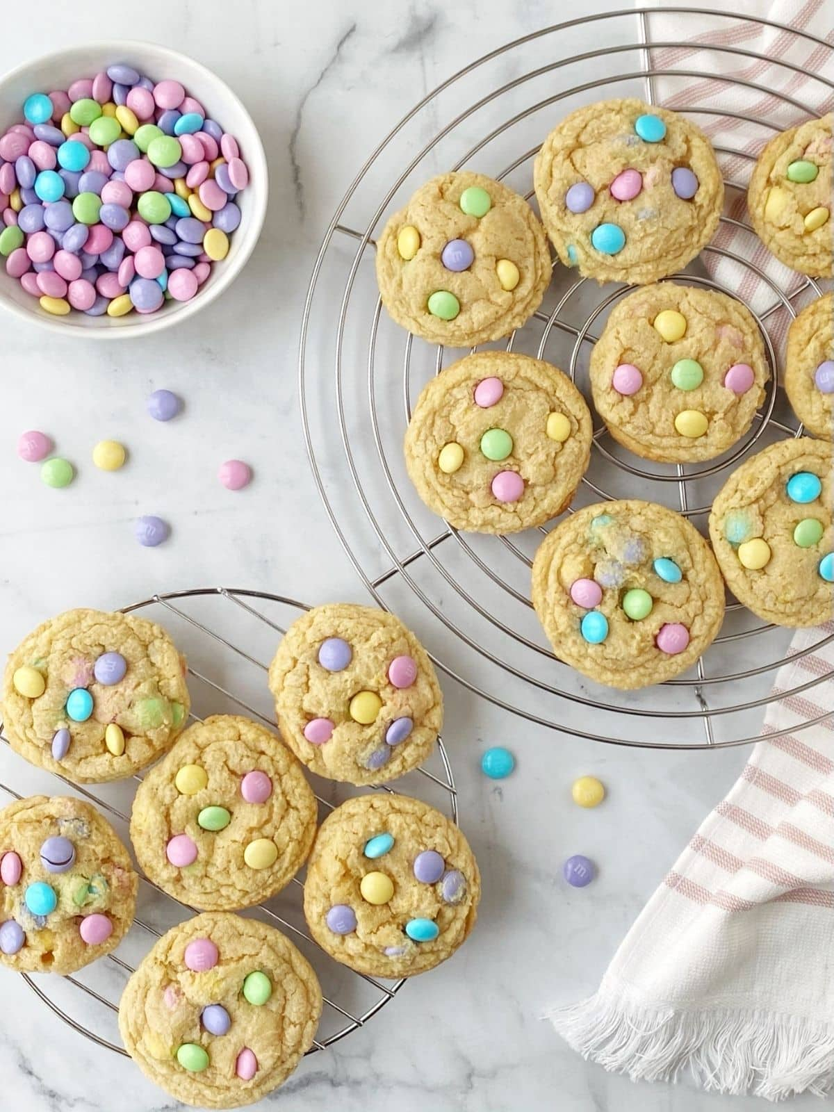 cookies on cooling racks with a bowl of M&M candies
