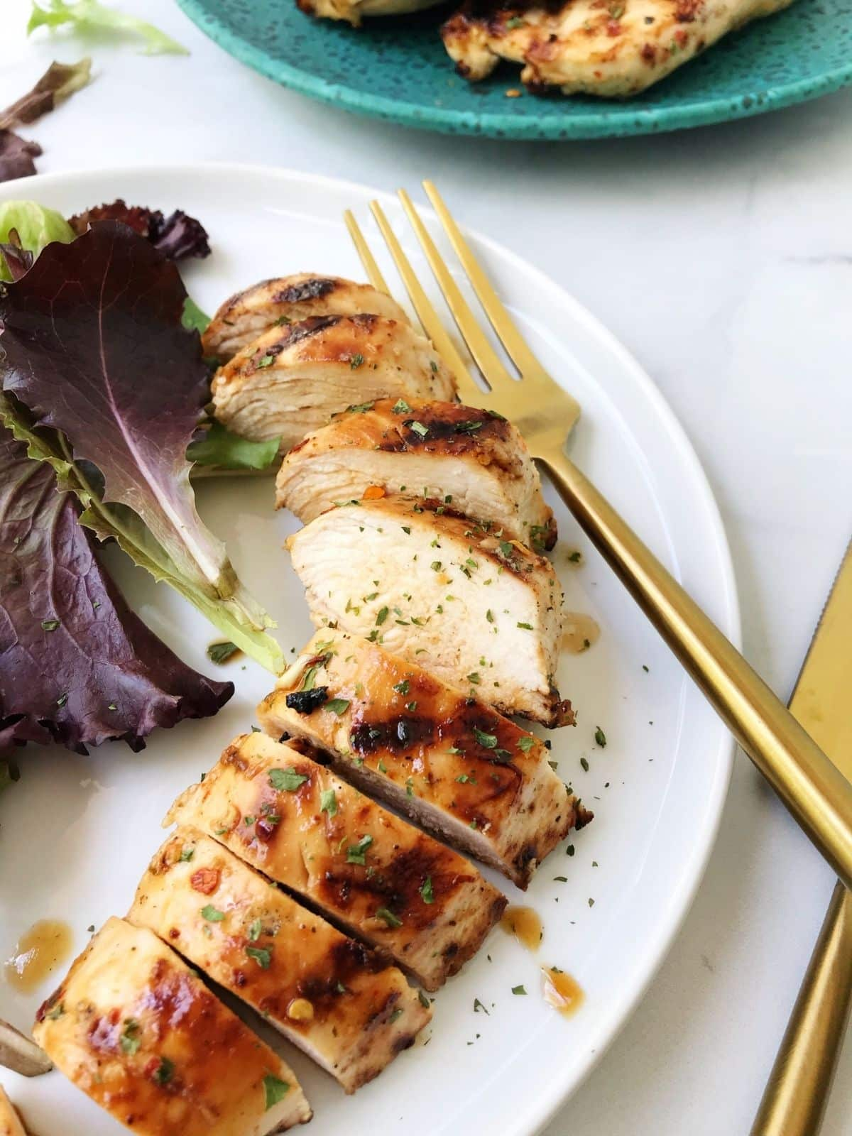 sliced chicken on a plate with a fork