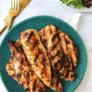 grilled chicken piled on a plate