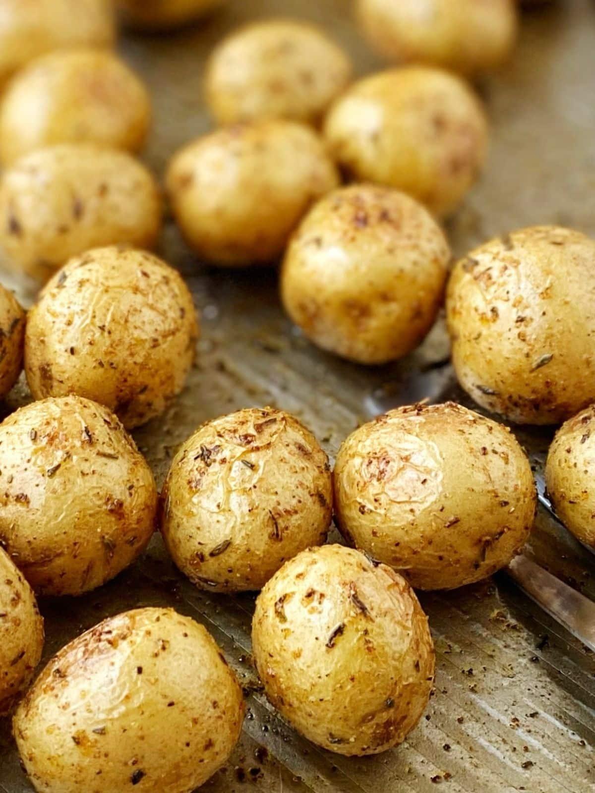 close up of potatoes on the sheet pan