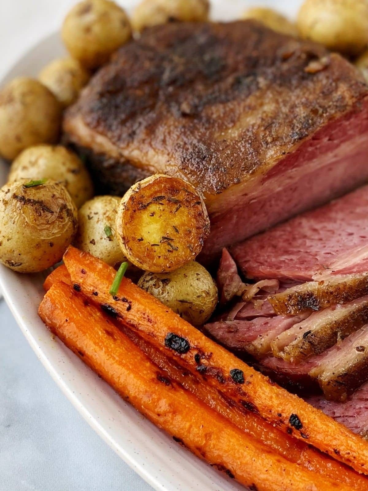 potatoes on a platter with corned beef and carrots