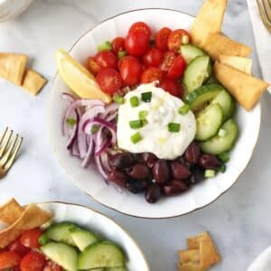 rice bowl with garnishes and pita chips