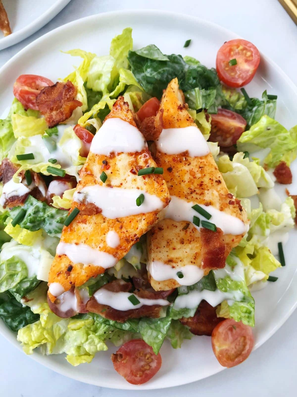 plate of BLT salad topped with hallouimi