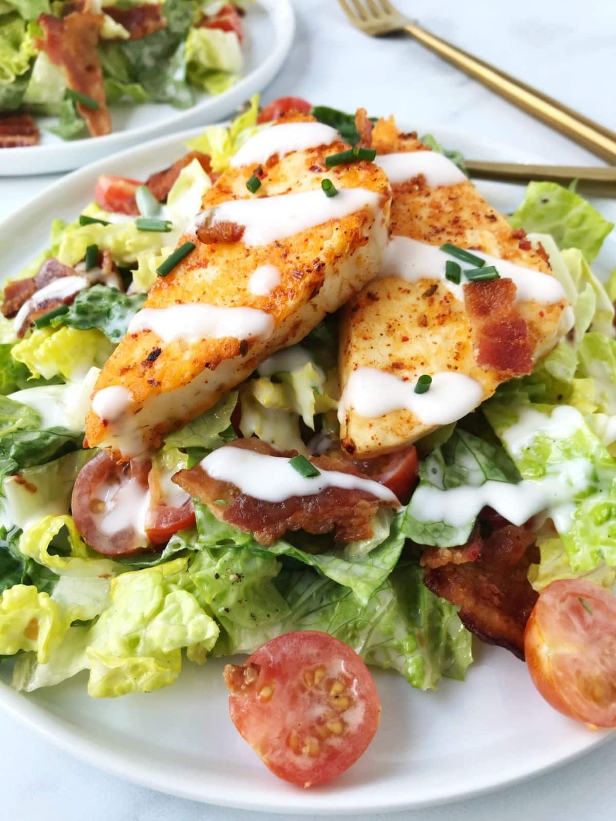 side view of salad with halloumi
