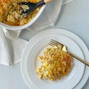 casserole on a plate next to the casserole dish