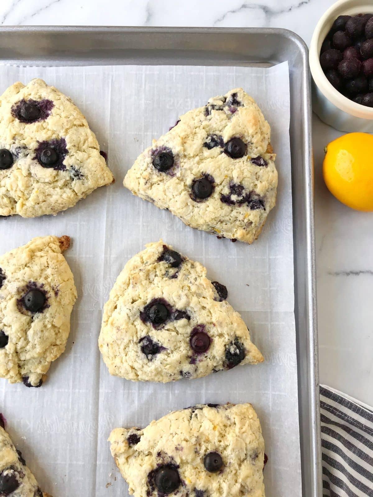 freshly baked scones on a sheet pan