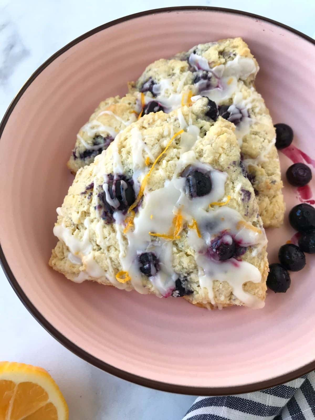overhead shot of glazed scones in a dish
