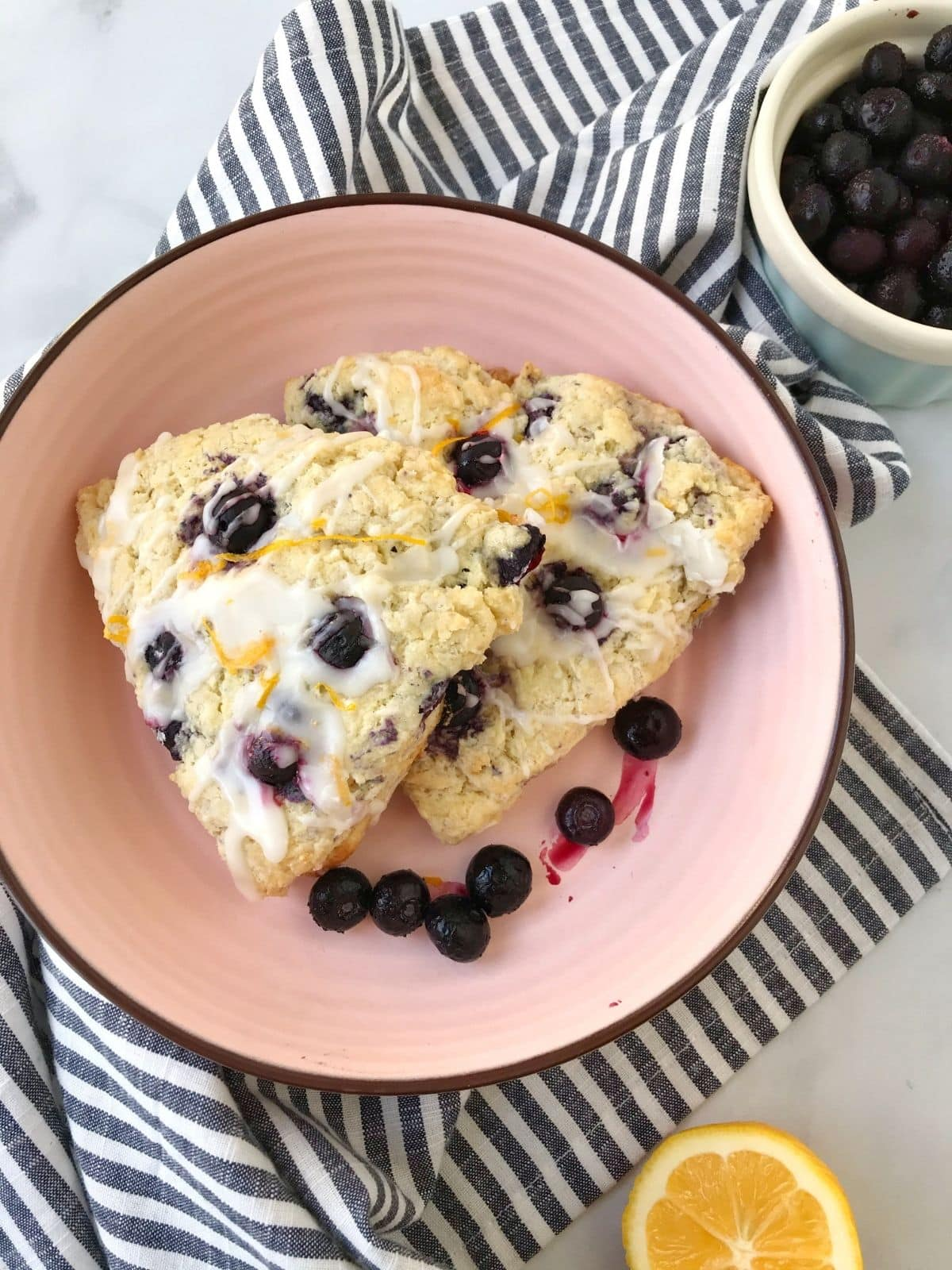 scones in a dish garnished with blueberries