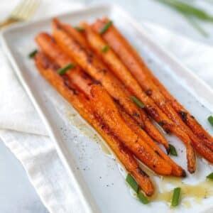 roasted carrots on a rectangular platter