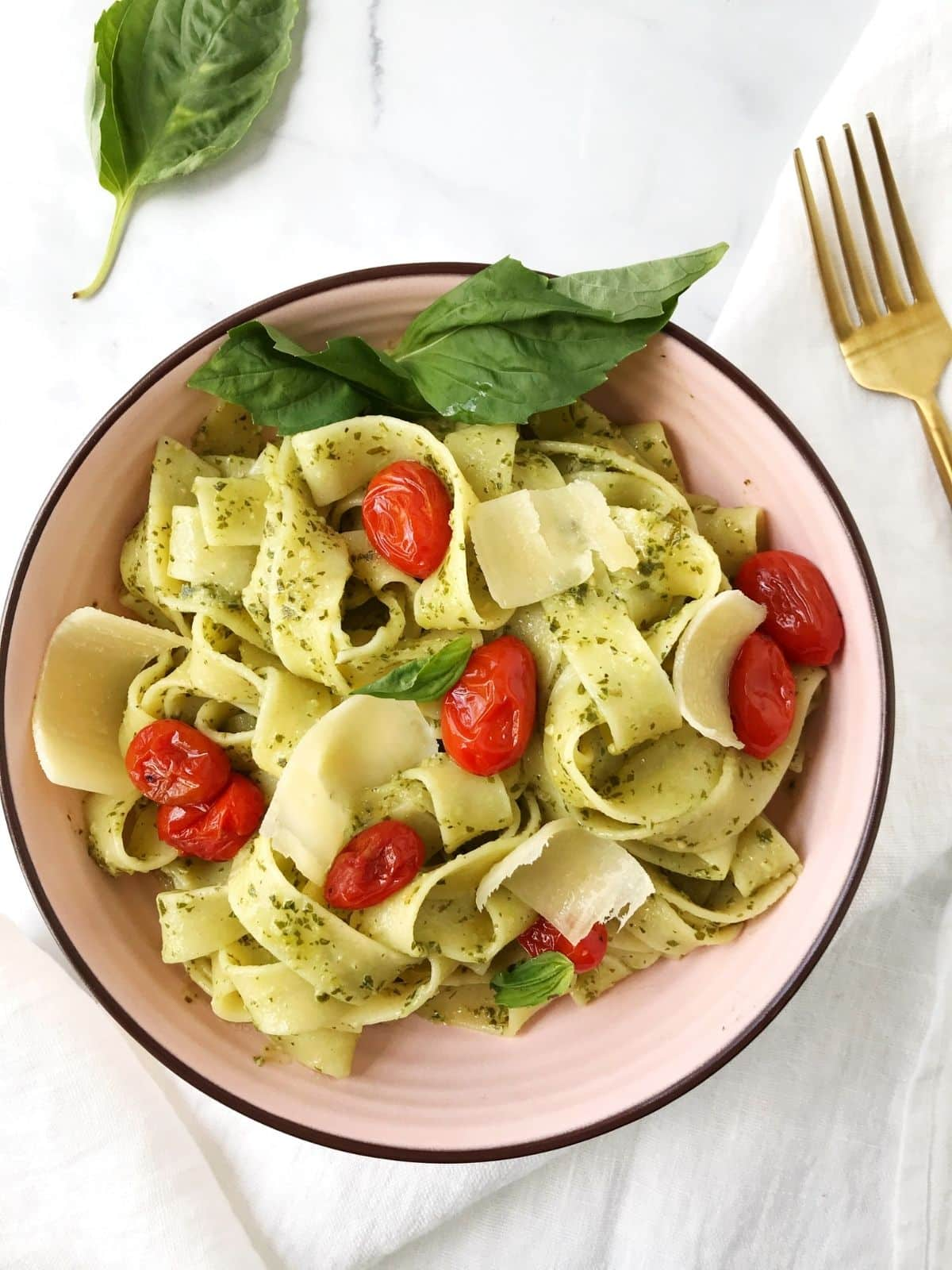 bowl of pasta with tomatoes and fresh basil