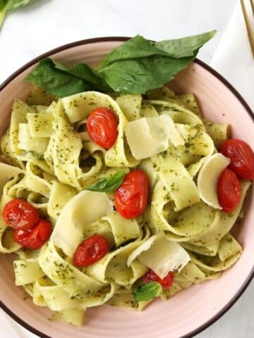bowl of pasta garnished with basil