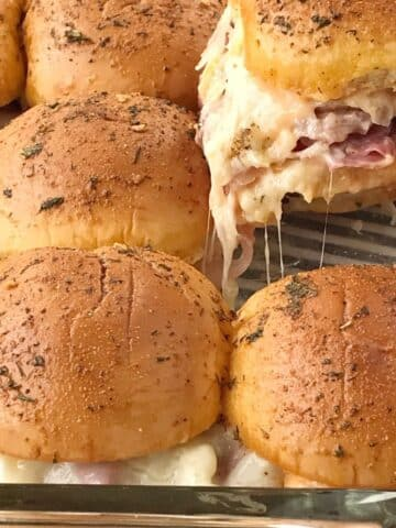 lifting a slider out of casserole of sliders