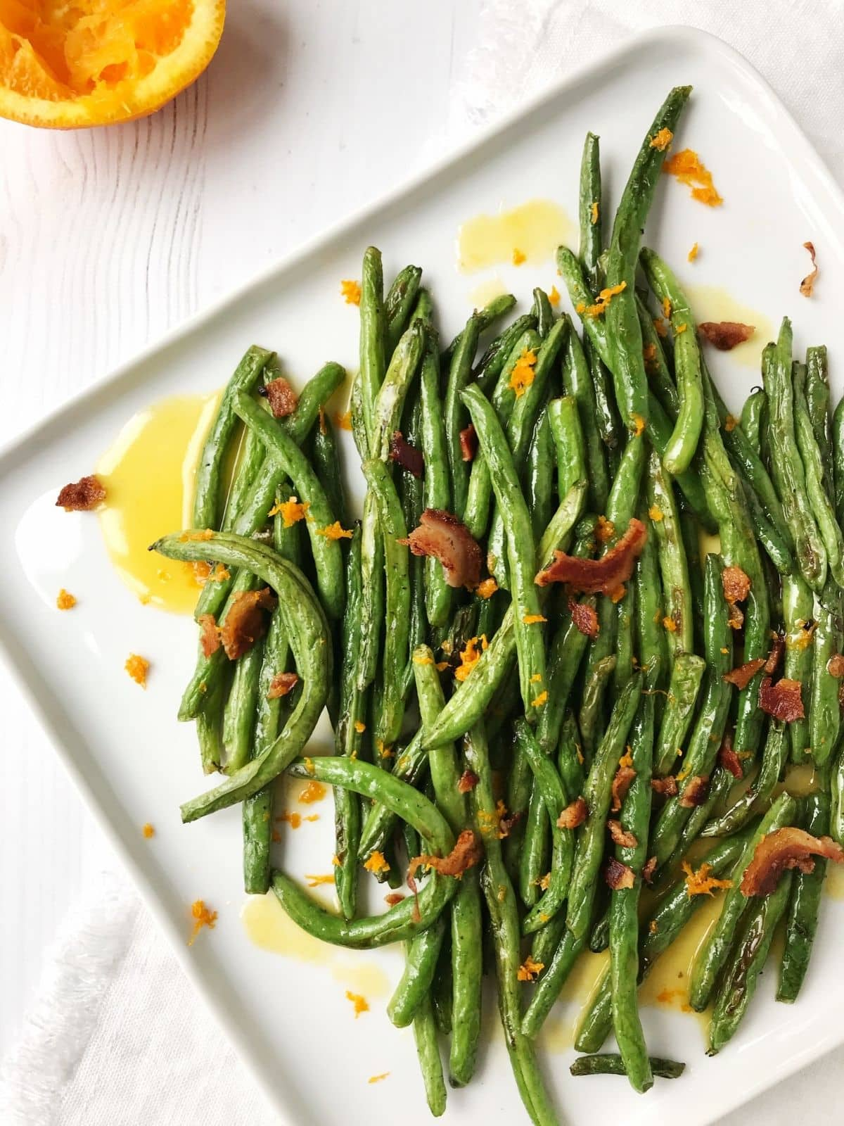 beans plated with pancetta and sweet glaze