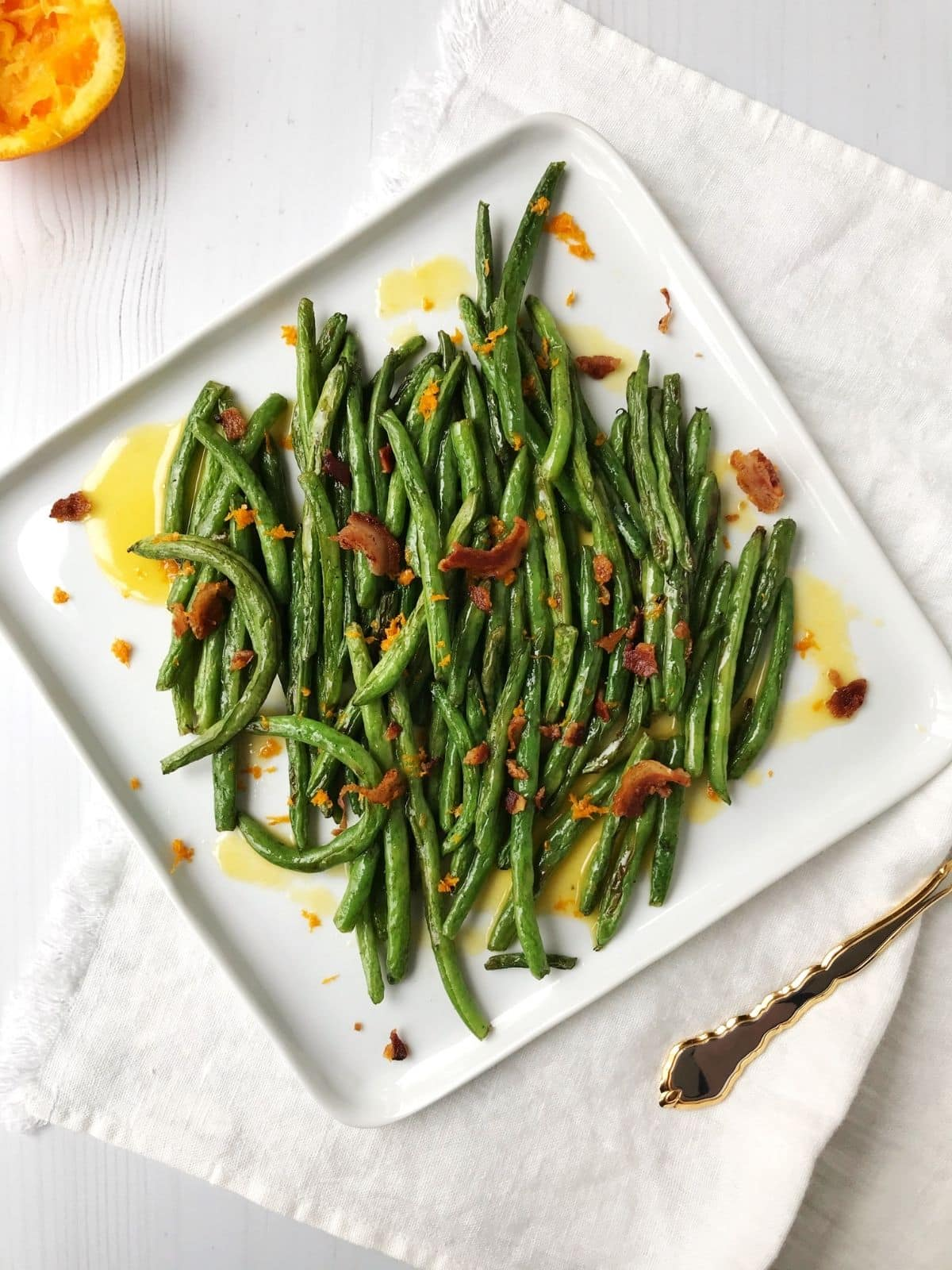 platter of beans topped with pancetta