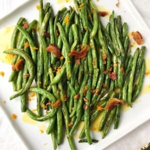 platter of green beans with a sweet and salty topping