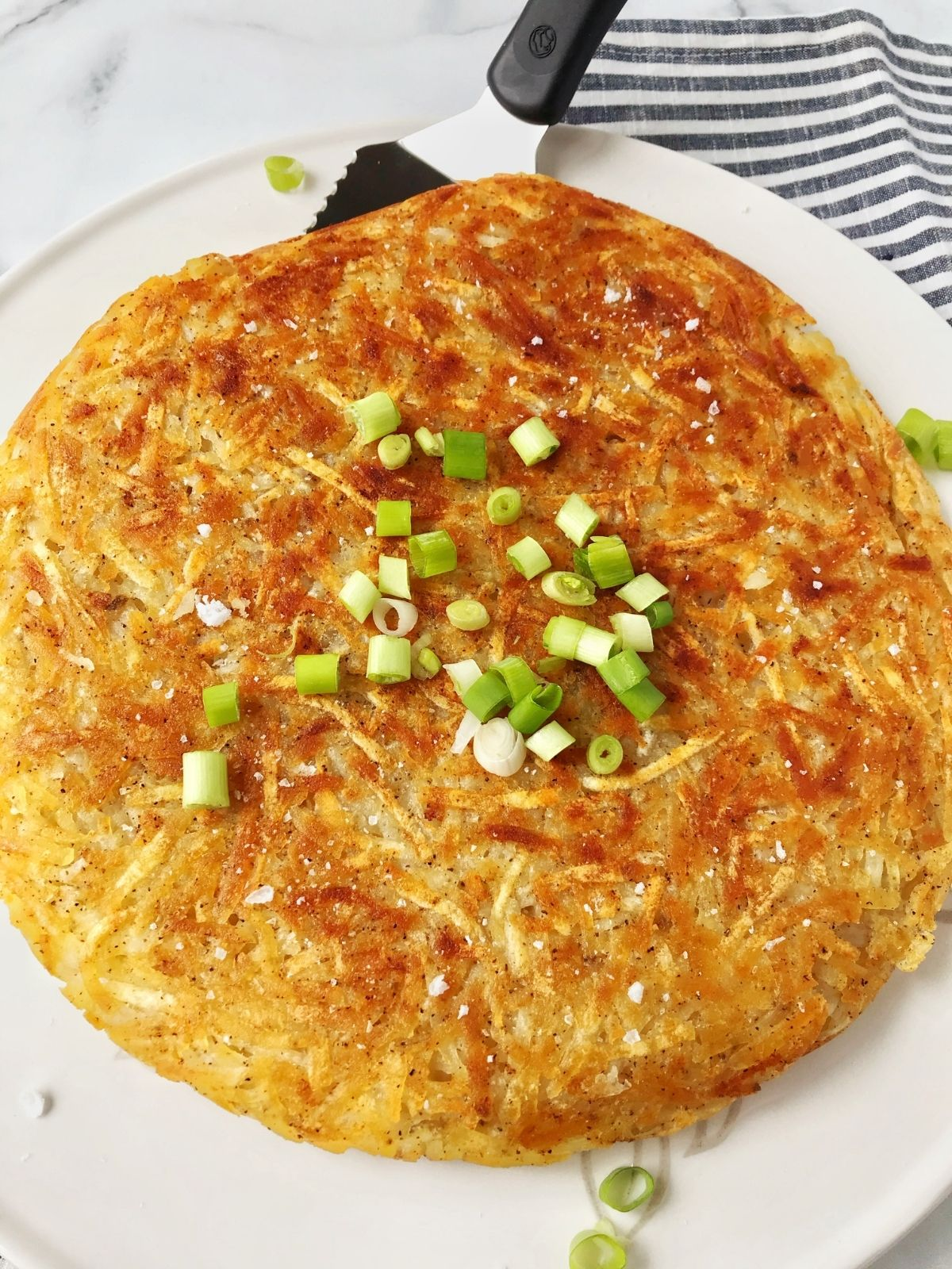 whole hash brown on a serving platter