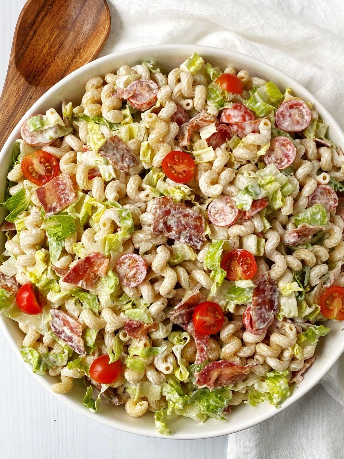white serving bowl of pasta salad