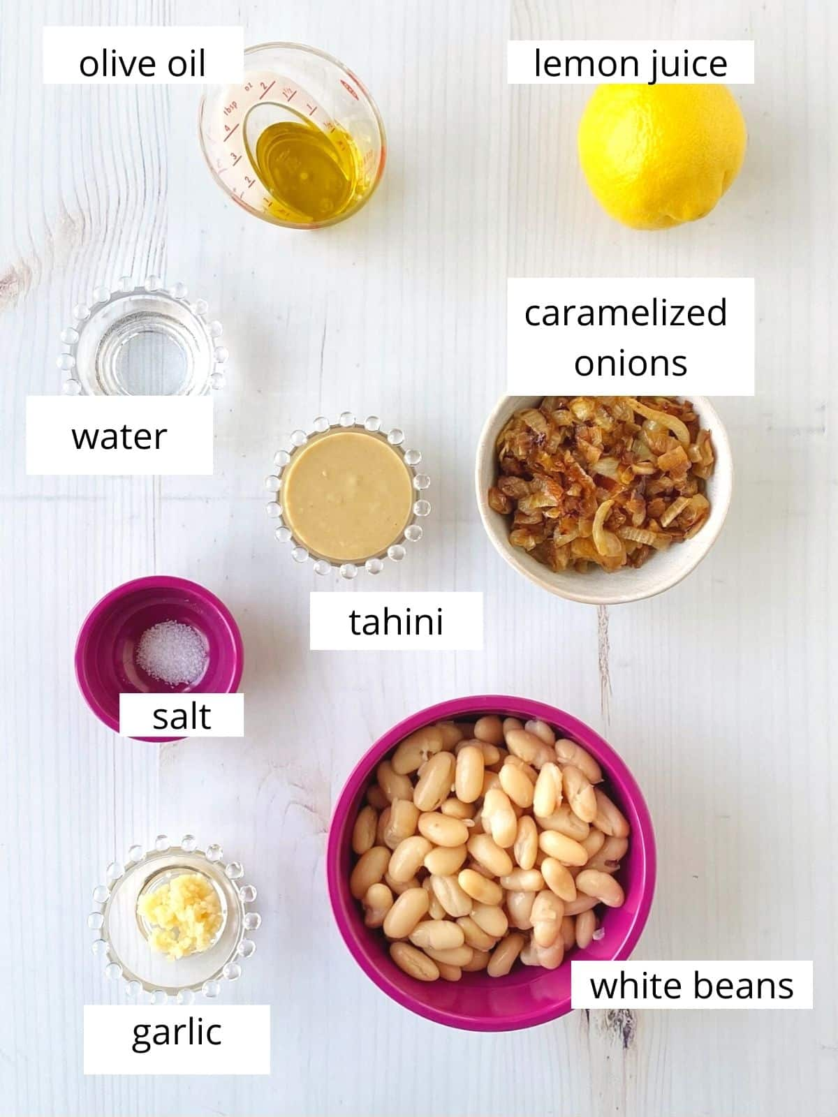 hummus ingredients - white beans, tahini, lemon, garlic, oil, water, caramelized onions