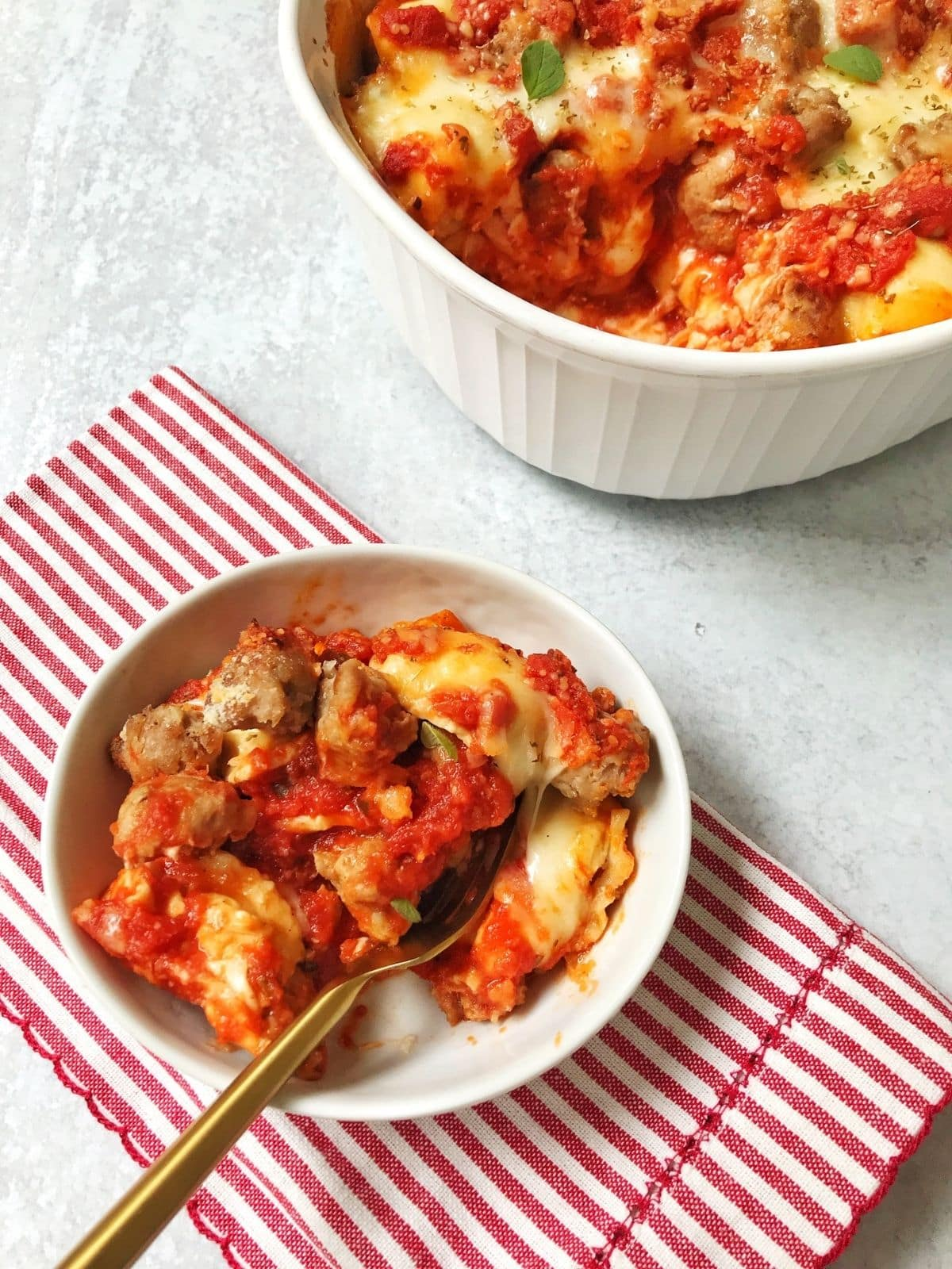 dish of ravioli and sausage bake