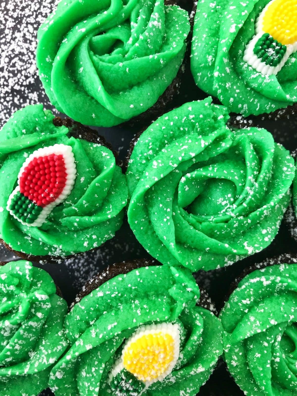 close up of cupcakes with green frosting