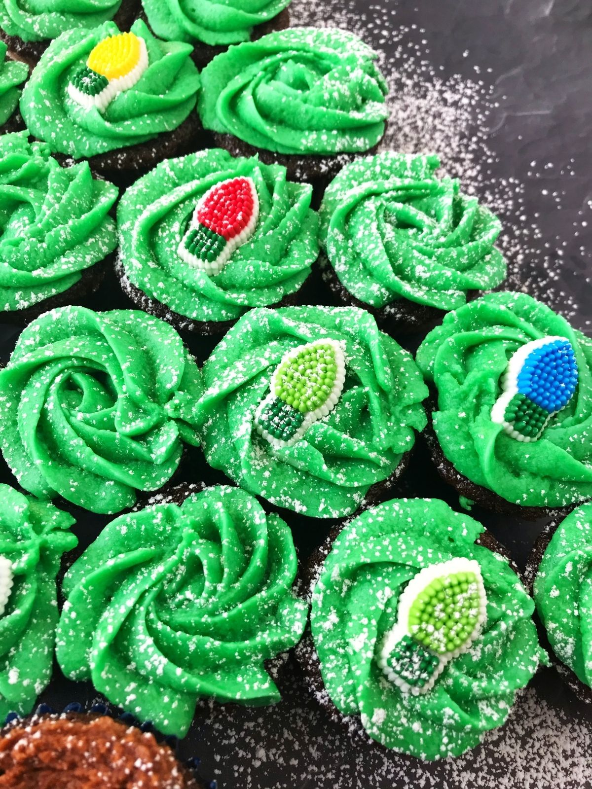 close up of green frosted cupcakes