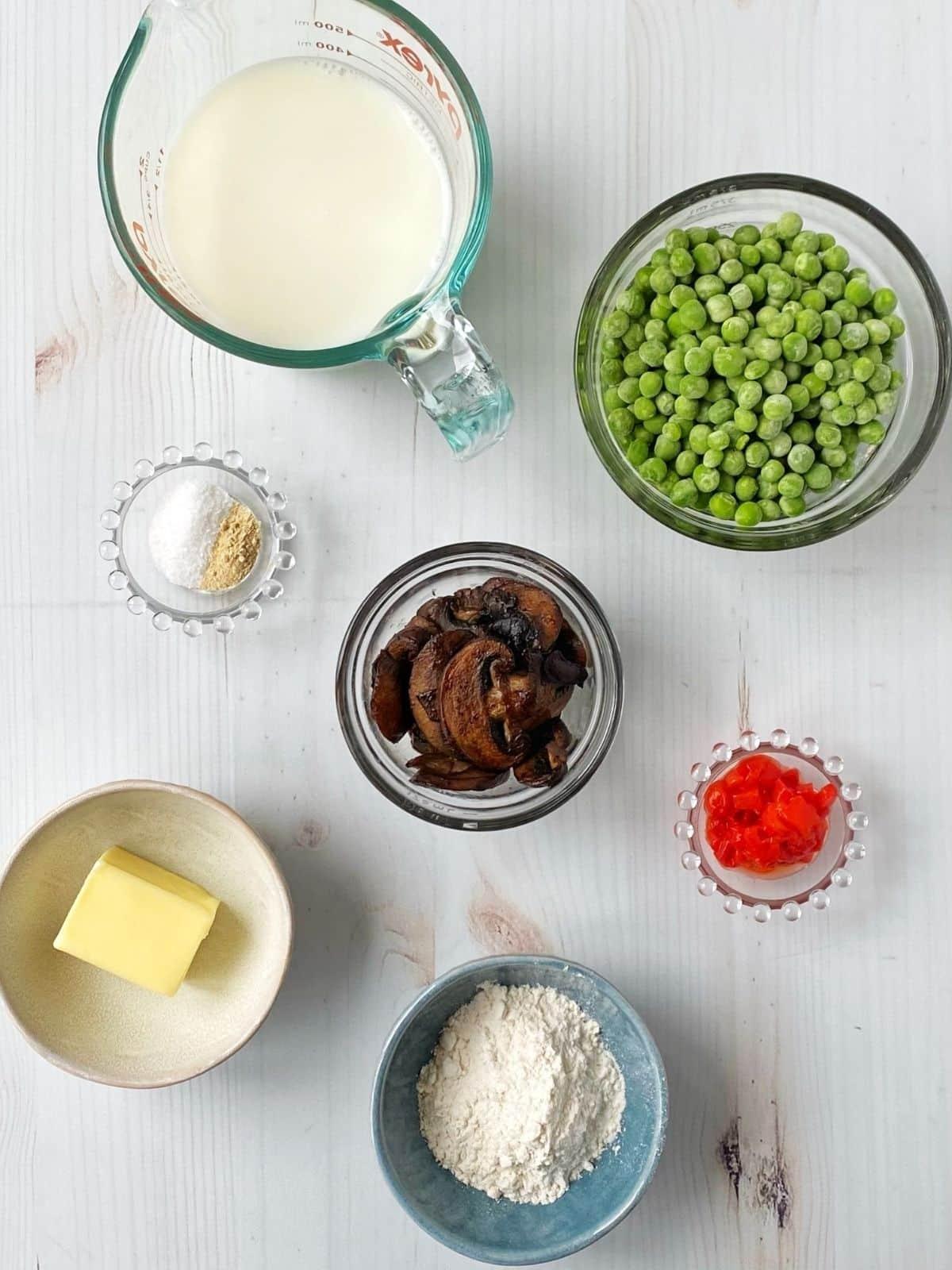 cream sauce ingredients - milk, flour, butter, peas, mushrooms, pimientos
