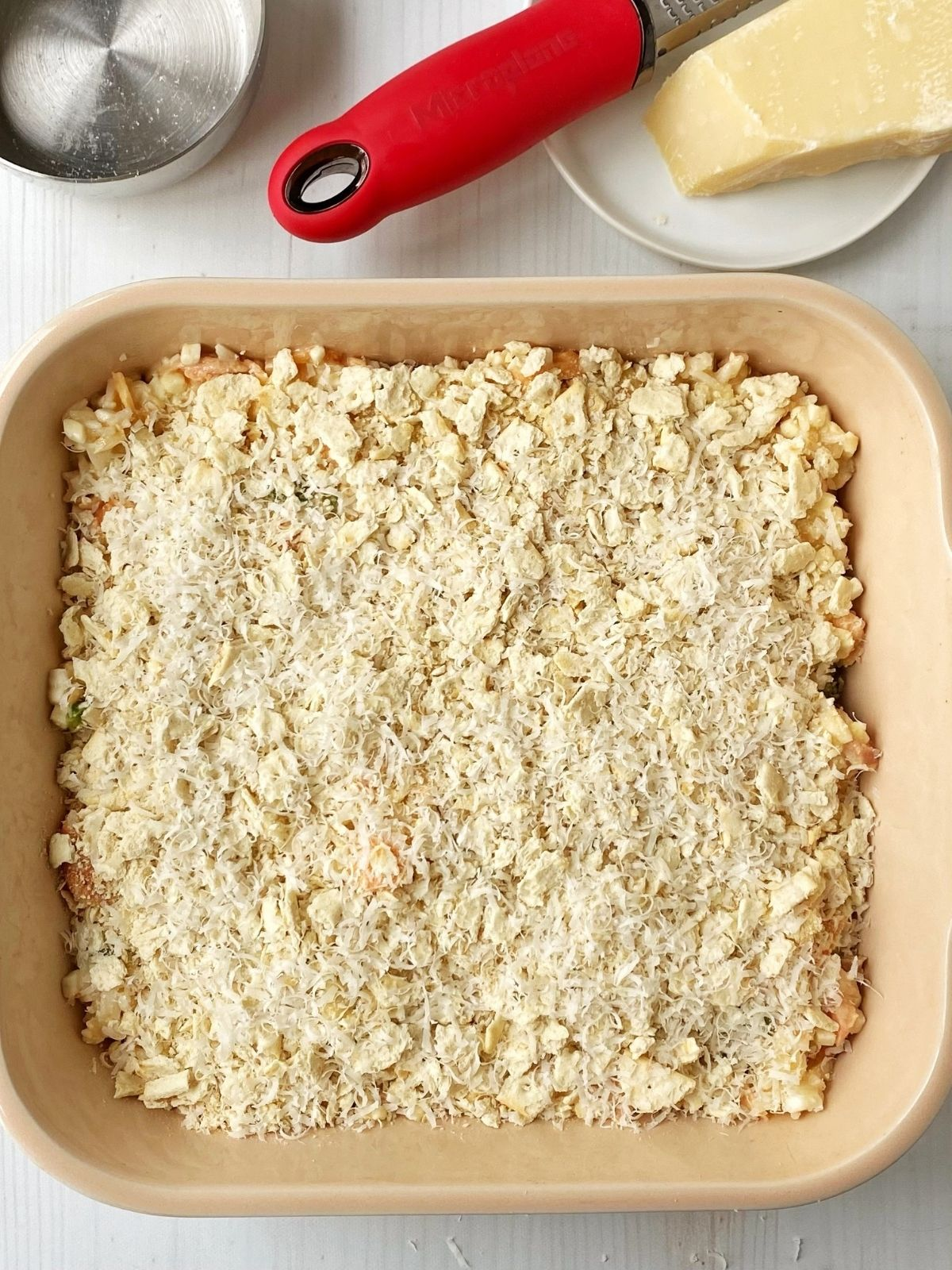 salmon mixture topped with cracker topping ready for baking