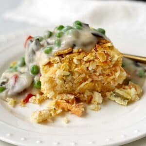 old fashioned salmon loaf topped with cream sauce on a plate