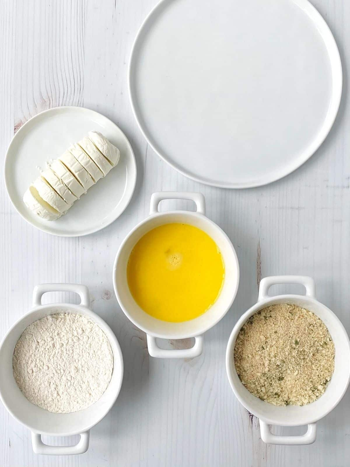 goat cheese and flour, egg, and breadcrumbs for breading the cheese
