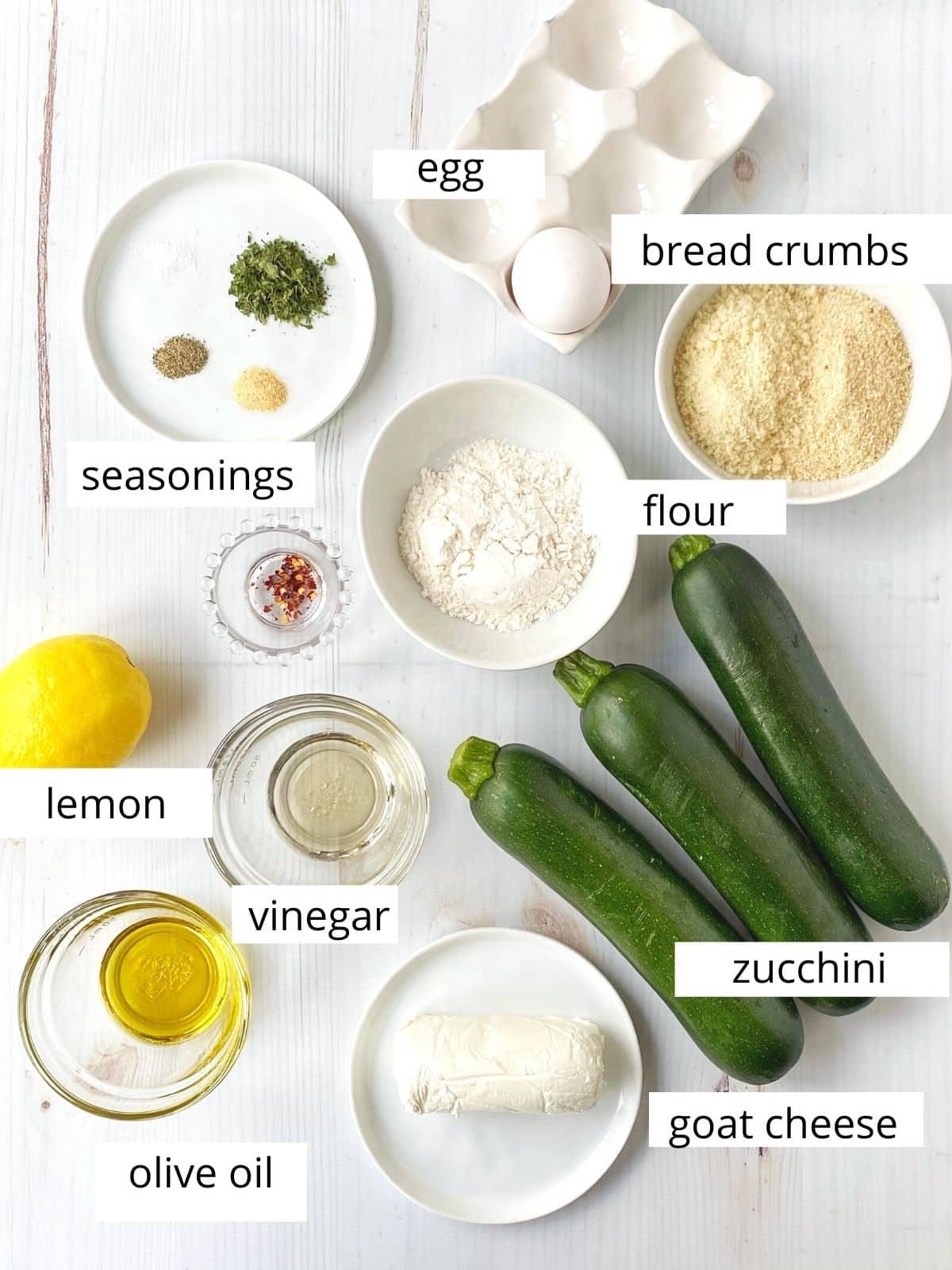 salad ingredients - zucchini, goat cheese, seasonings, breadcrumbs, oil, vinegar, lemon