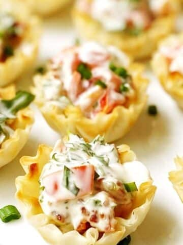 close up of BLT cups on a white platter