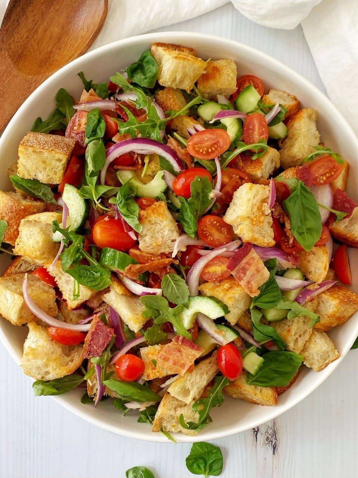 panzanella salad in a white serving bowl