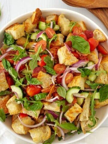 white serving bowl of panzanella salad