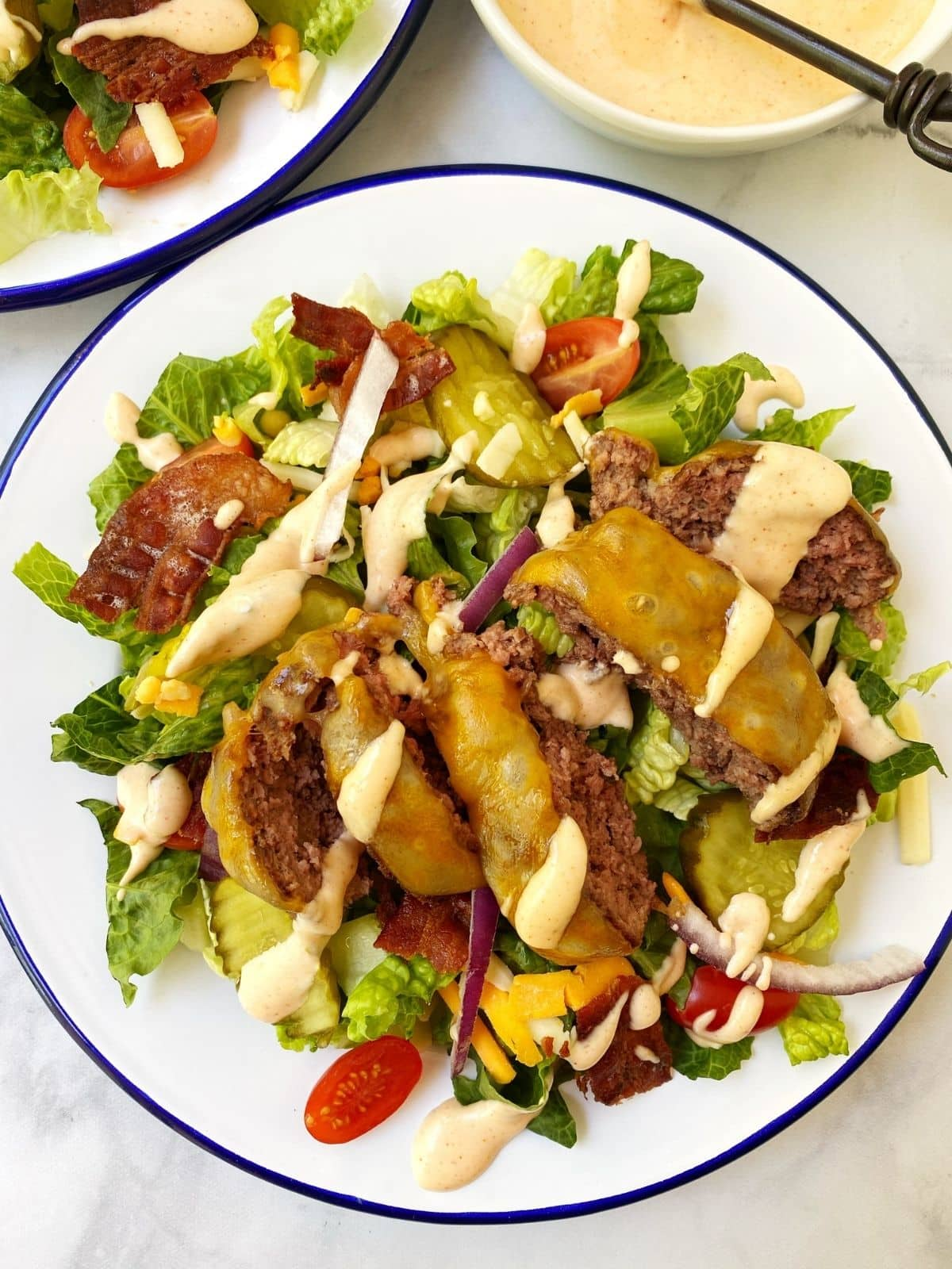 white plate of burger salad