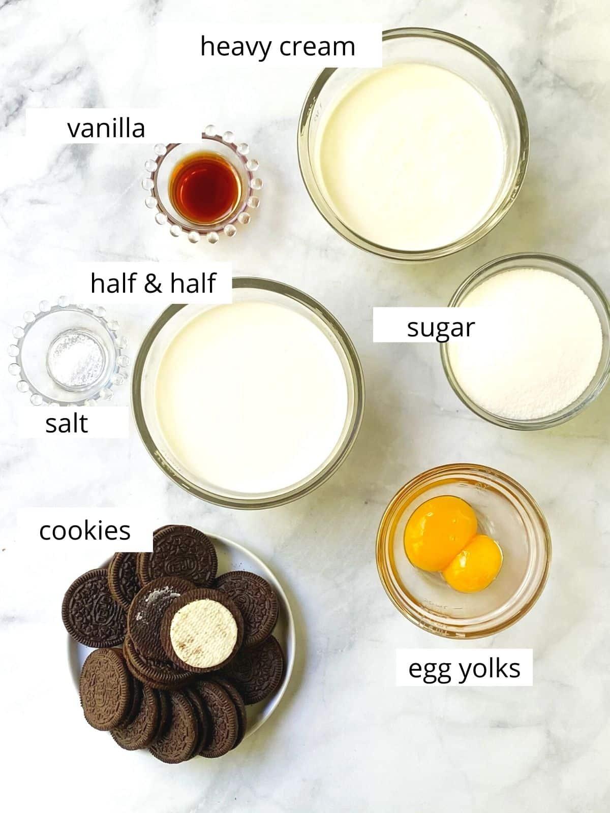 array of ingredients - cream, half and half, sugar, egg yolks, vanilla, salt, and cookies
