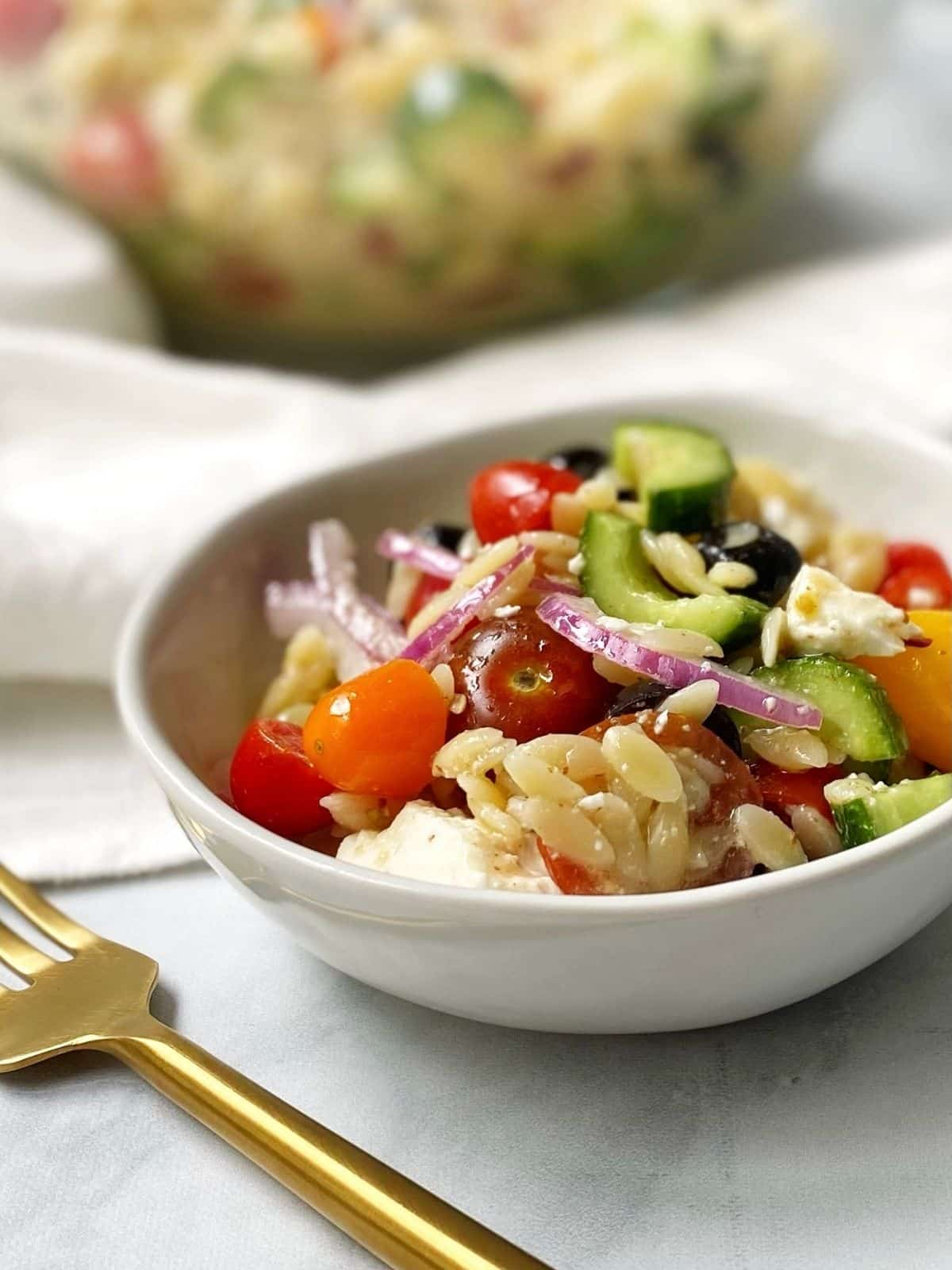 side view of small dish of salad in a white bowl