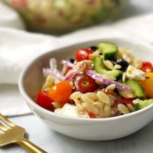 close up of serving of salad in a white bowl
