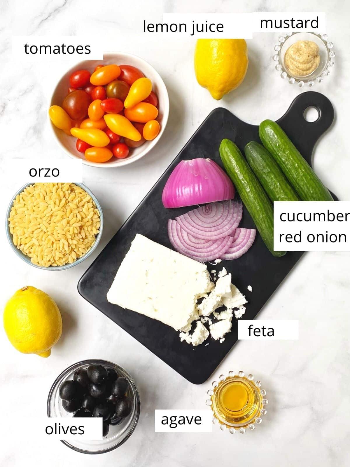 ingredients - tomatoes, orzo, cucumber, onion, olives, feta, lemon juice, mustard, agave