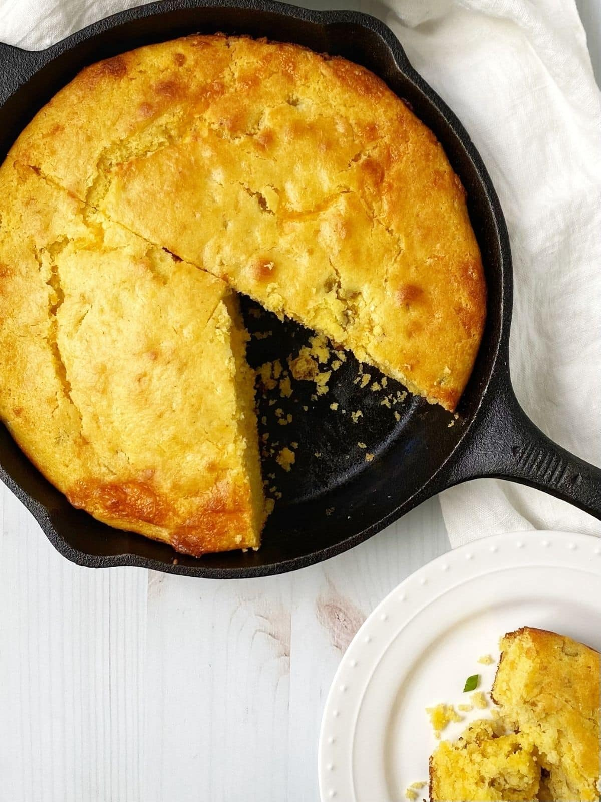 skillet of cornbread with a slice removed