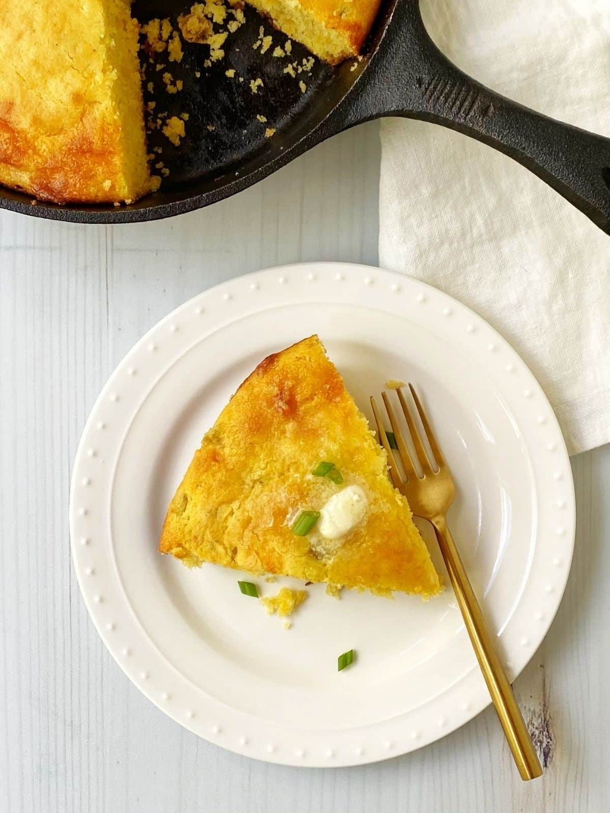 overhead picture of slice of cornbread on a plate