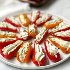 close up of stuffed peppers on a white plate