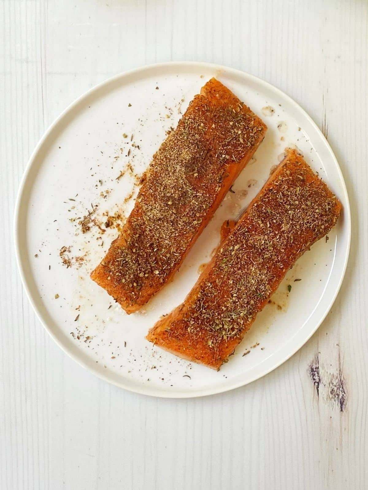 raw salmon coated with spice mixture
