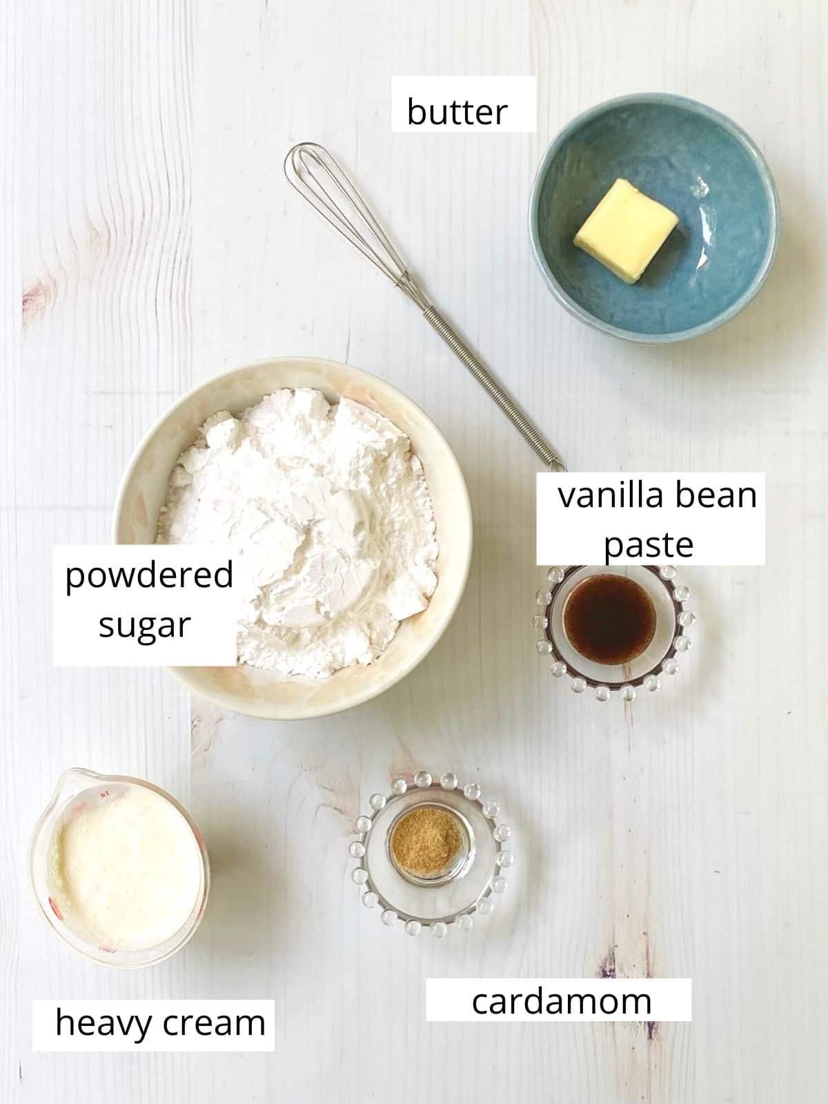 icing ingredients - powdered sugar, butter, cream, vanilla bean paste, cardamom