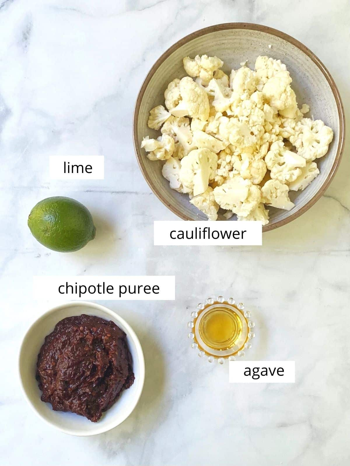 array of ingredients - cauliflower florets, lime, agave, and chipotle puree