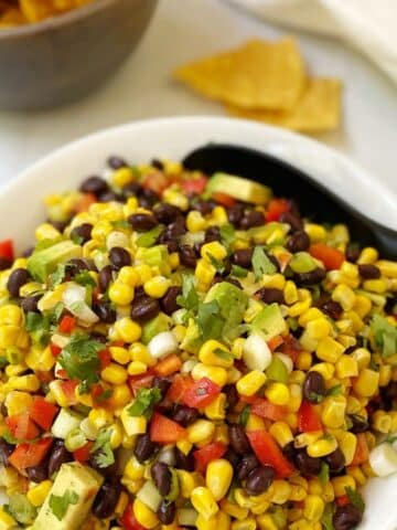 close up of bowl of salsa with tortilla chips.