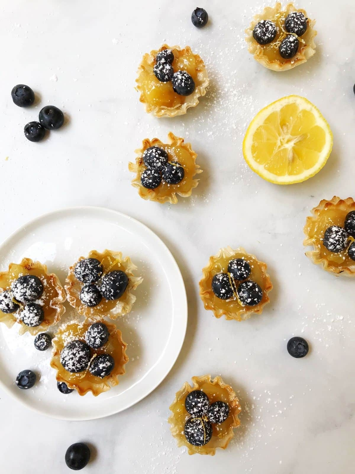 overhead shot of tarts on a white plate
