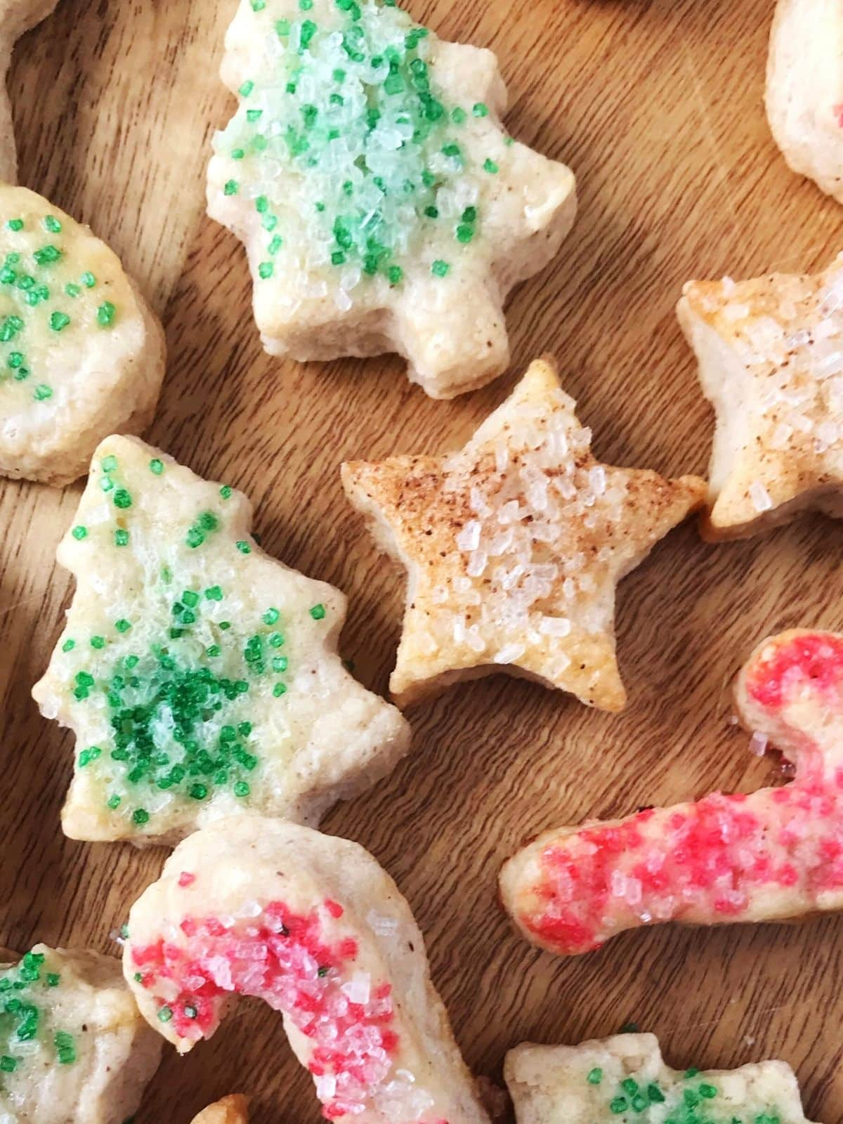 close up of candy cane, star, and tree-shaped cookies