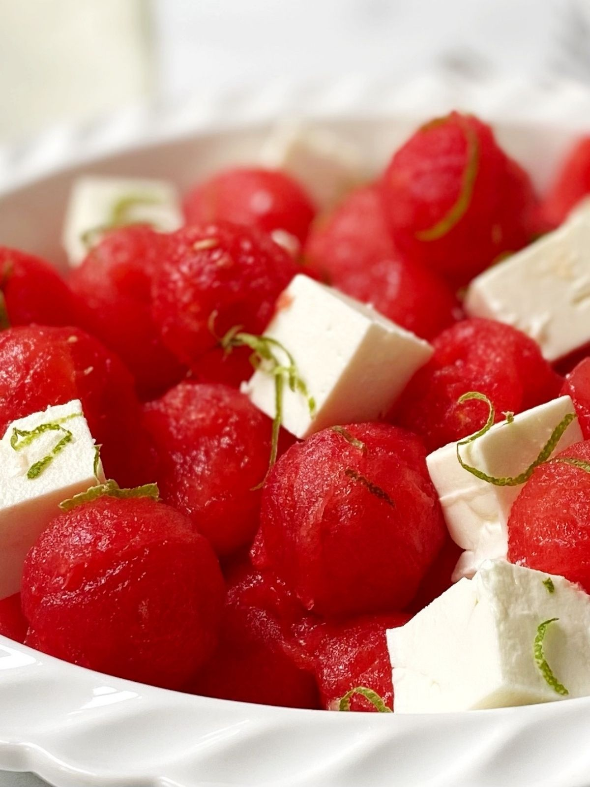 close up side view of dish of watermelon salad