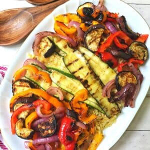 orzo with grilled vegetables on a platter.