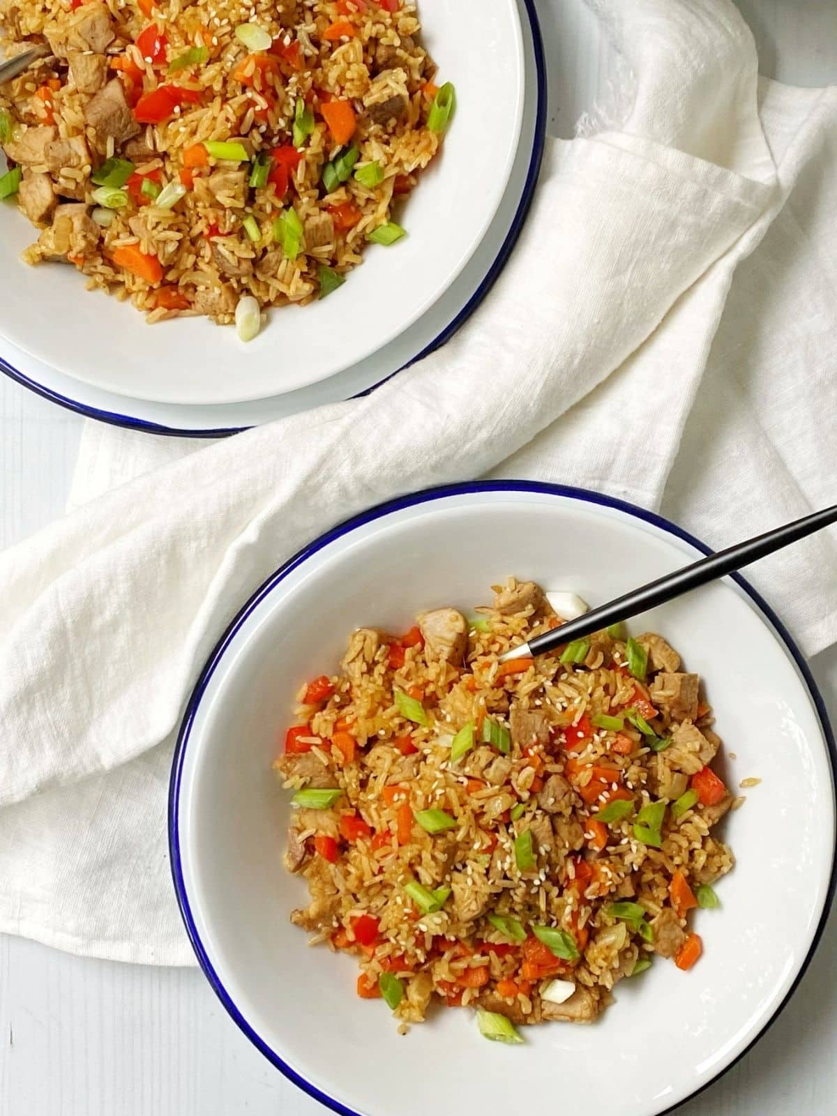 top down shot of fried rice in white bowls